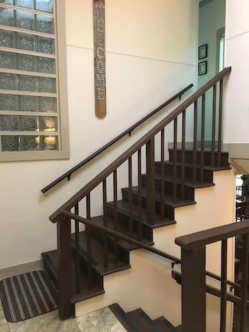 Stairs in entrance hall, down to family room, up to two queen bedrooms