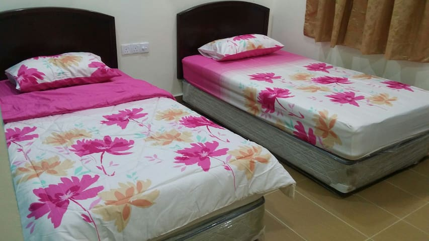 Plush single beds with fresh sheets