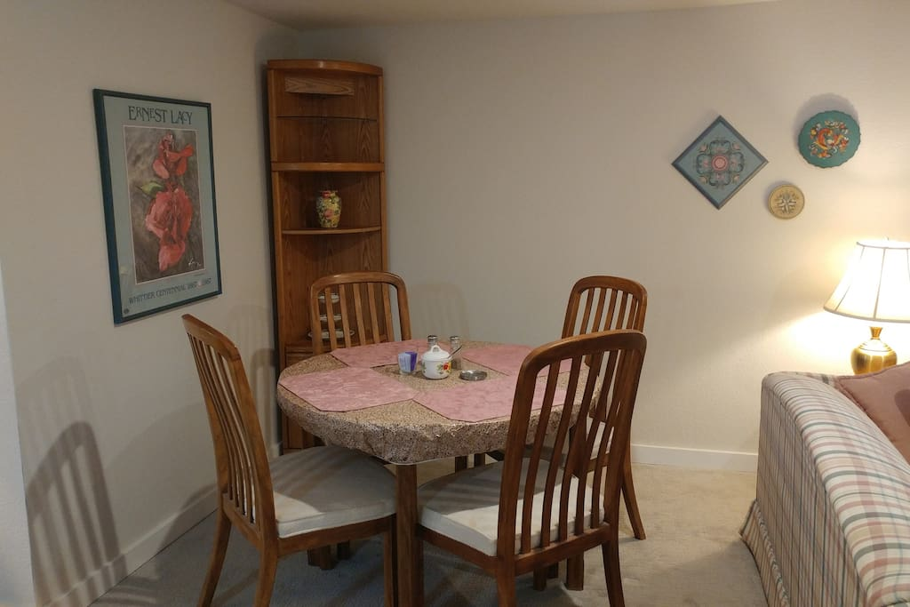 Cozy dining next to living area, directly off kitchen.  The table has two extra leaves and so can be extended to make a large work space that still has room for three to dine.