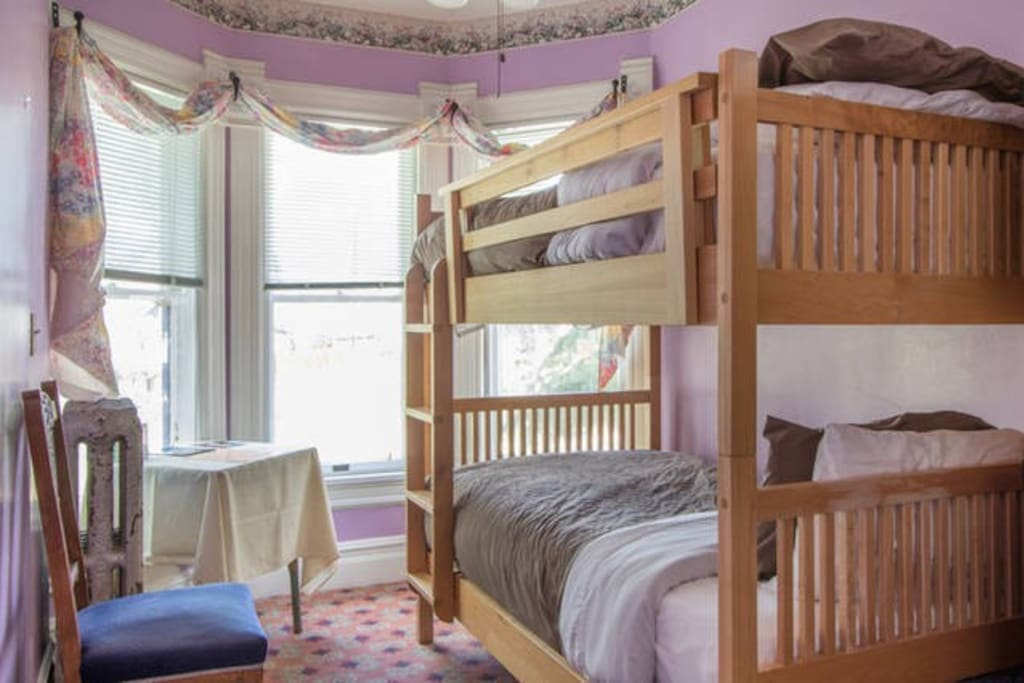The second room has a bunk bed with a turret window looking out over 8th street.