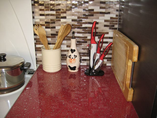 kitchen detail, utensils, knives and olive oil