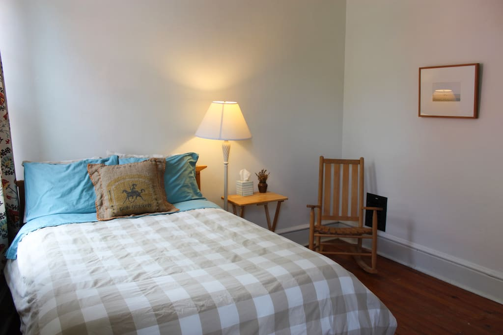 A comfortable bed, reading lamp, bedside table, and rocking chair will welcome you.