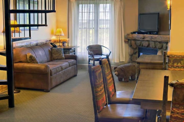 Lounge on the plush sofa and warm up next to the fireplace while you watch a movie on the flatscreen