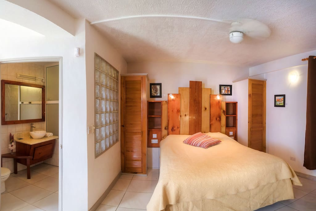 Here is a first look inside the Garden Room. A perfect space for a cozy couple getaway. Queen size bed, wooden interior, double wardrobe, spacious bathroom, complete with free amenities.