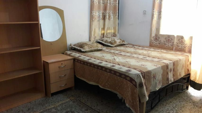 Furnished big room in family building.