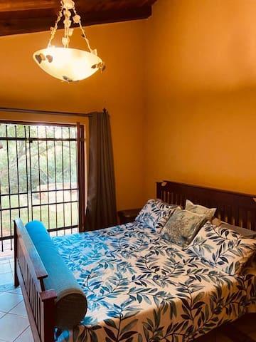 Master bedroom, en suite with king size bed.