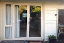 Double glazed French doors lead into unit.