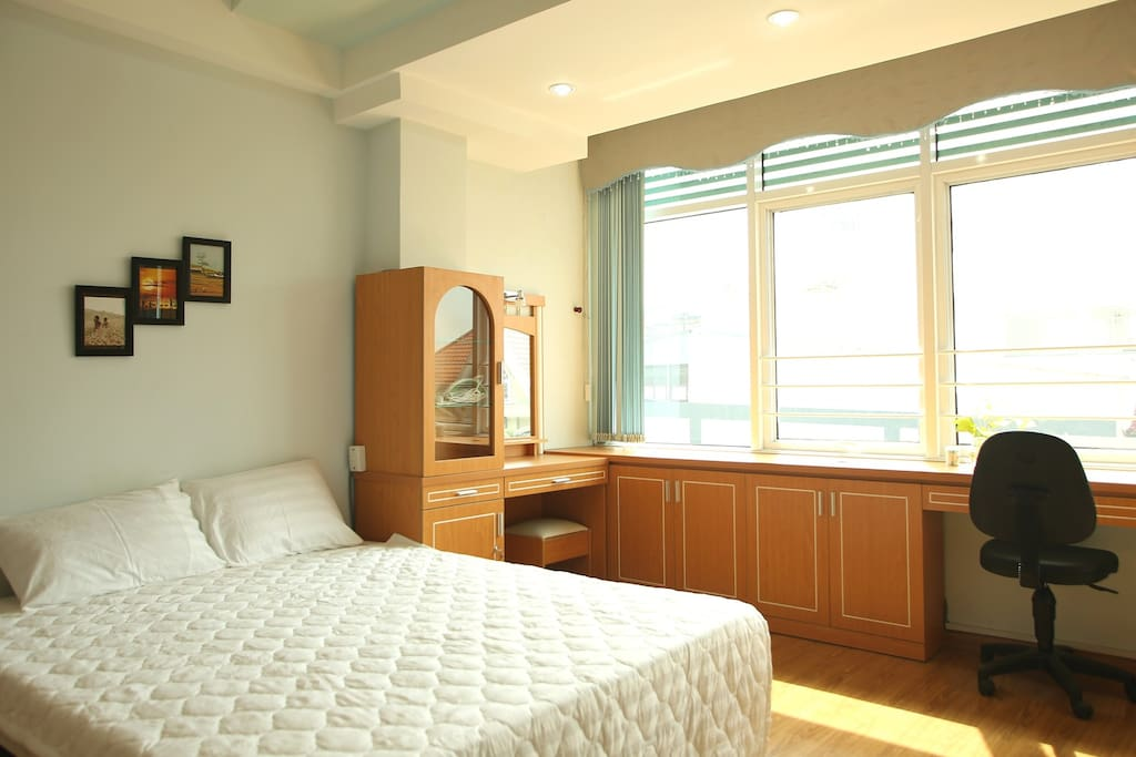 The cozy studio with full necessary amenities: nice decor closet, hangers, comfortable double bed, iron, working desk, dinning table, television, water- tea- coffee.