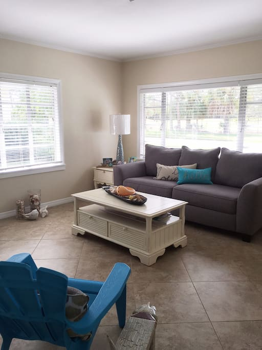 """""""The Cottage"""" is located in a quite neighborhood  with a view of the Country Club golf course.  Picture of the living room with Queen pull out sofa.  T.V./cable/wifi included."""