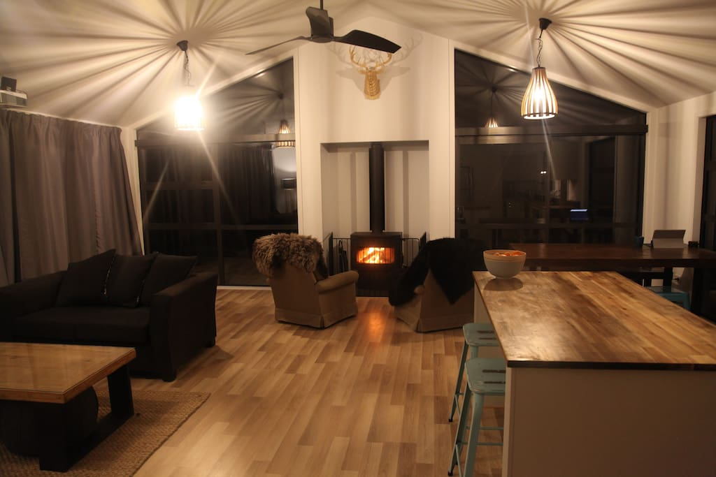 The spacious living room with log fire