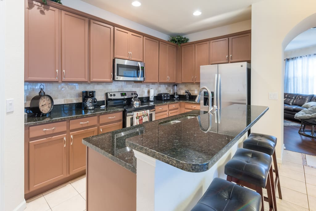 Fully-equipped updated kitchen with stainless steel appliances