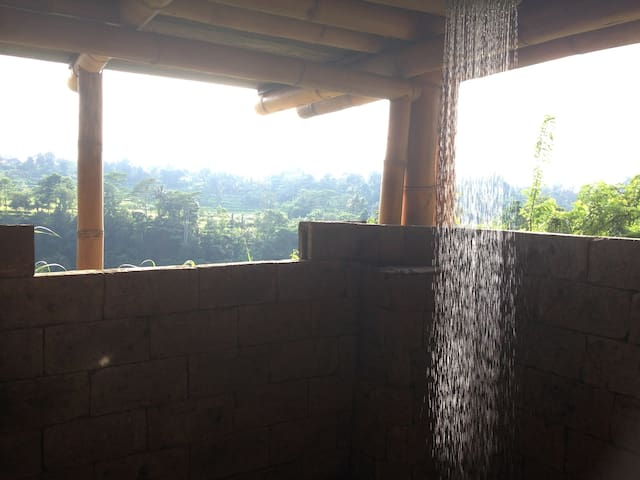 A shower with a view across the Ayung River gorge in the mist.