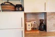 Kitchen with toaster, kettle and coffee grinder