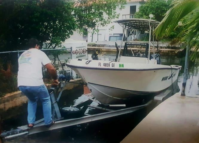 Throw back. Taking my 21 Mako out of the water. Nice to have your own boat ramp.