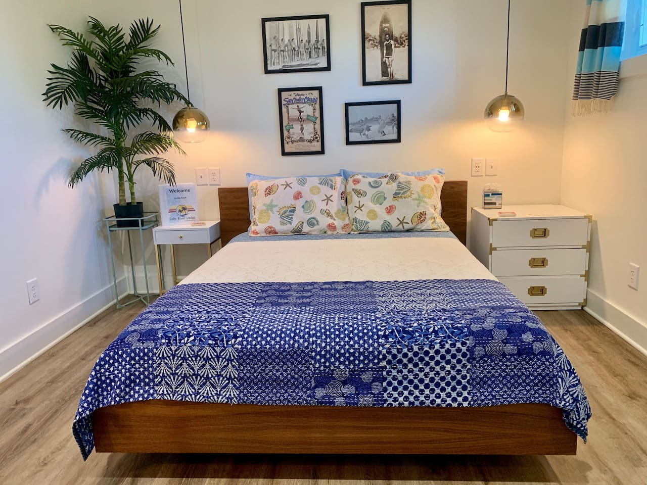 Room #6 at Folly River Lodge has a super comfortable queen-size foam mattress with night stands on both sides and soft bedding