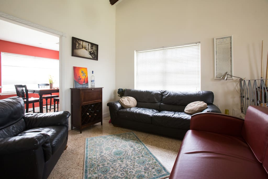 This space is great for relaxing and chatting about your day in the big easy . The brick color  love seat is a pullout .