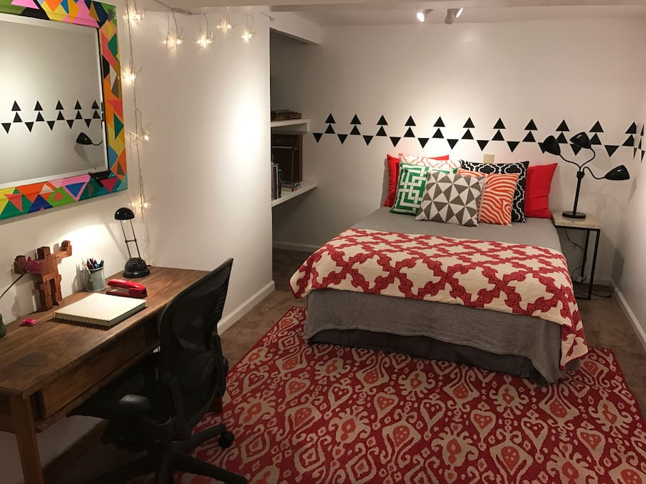 Queen bed and desk with Herman Miller Aeron chair