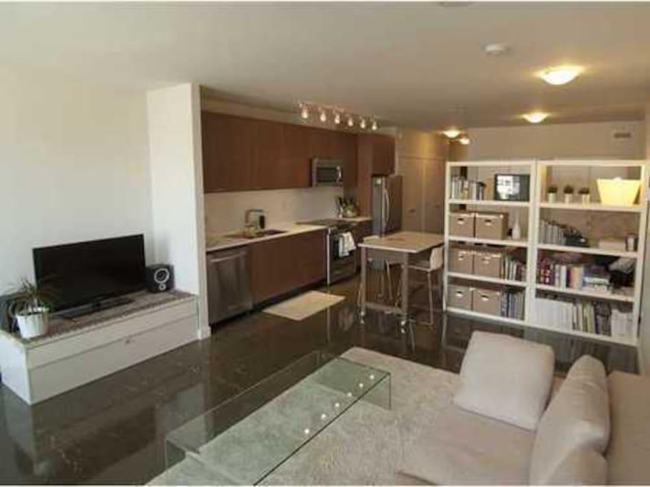 Full kitchen set-up (oven, microwave, pots, pans, refrigerator, etc.)