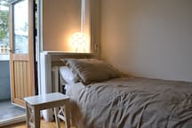 The other bedroom is smaller with a twin bed and it opens out to a small balcony.