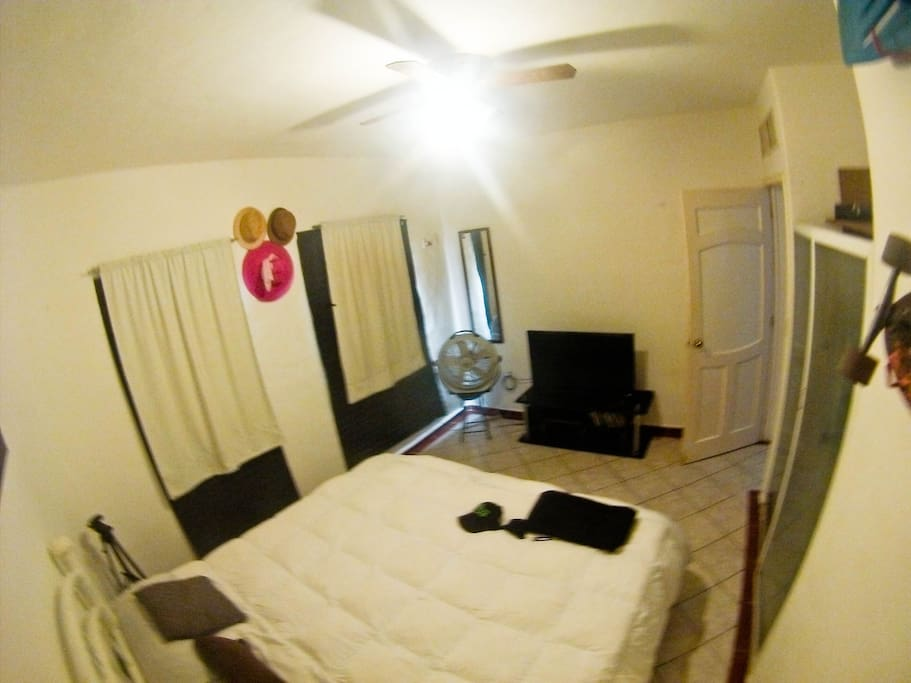 Spacious room with king size bed air conditioning, 40-inch screen, 2 fans, as well as snorkeling equipment, sun hats some books, audio system, long board and closet