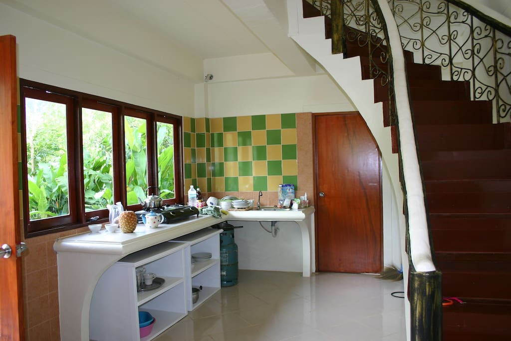 Kitchen and curved staircase