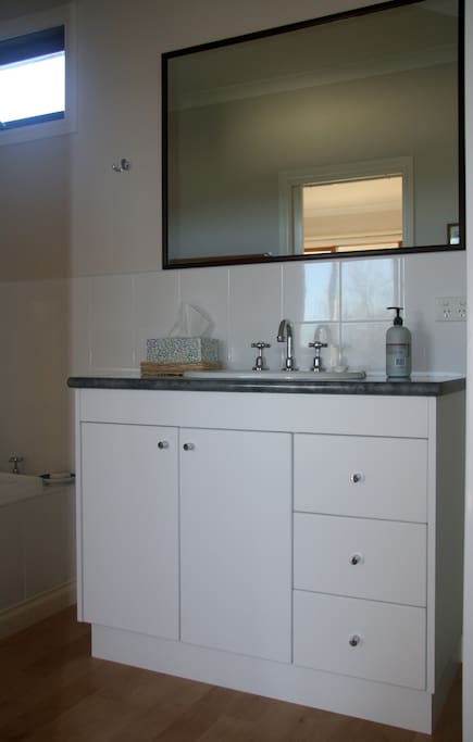 Spacious bathroom with bath, shower and separate toilet