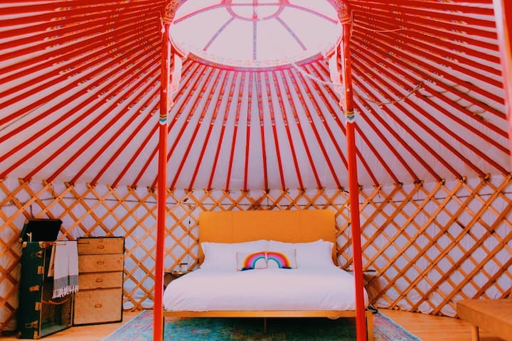 20' diameter Mongolian yurt with king-size bed, luxury linens and hand-painted decor.