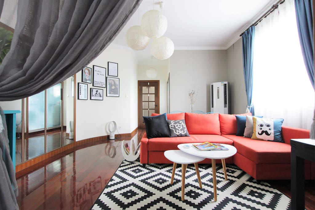 Spacious living room has a comfortable sofa bed. Perfect for travelers who need to sleep separately.
