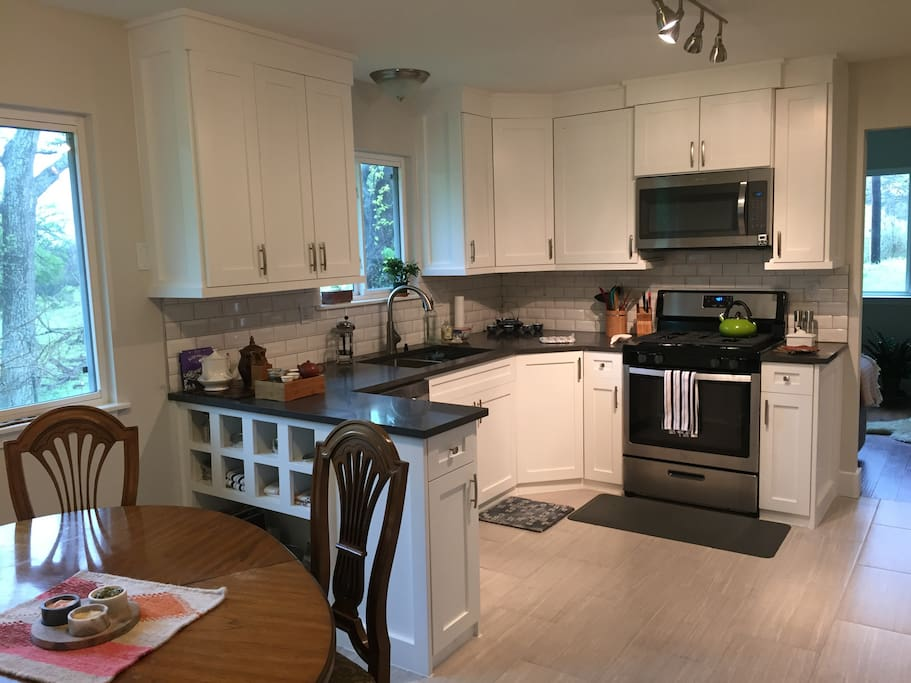 Kitchen has all new appliances. Dining area seats 4