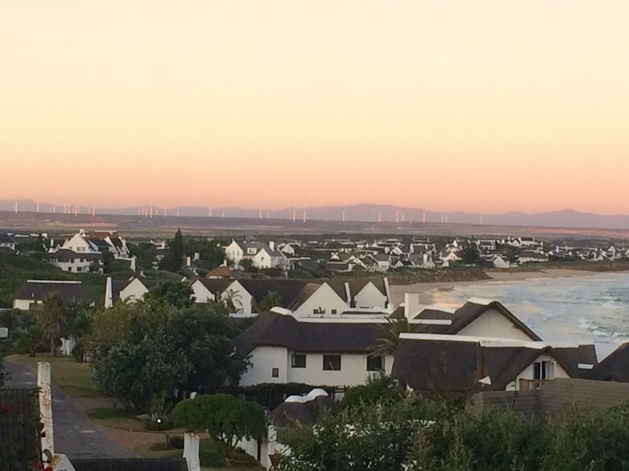 Sunset over St Francis with wind farm in the distance
