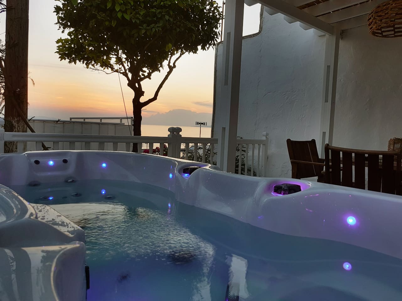 Veranda with dinning table , sunset view overlooking the Chora and a 2 person hot tub.