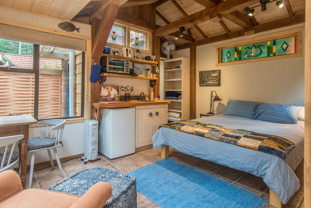 This is a compact space but is comfortable, attractive and has most amenities. This photo was taken with a wide angle lens making it appear larger than life!