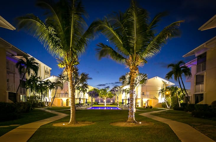 The grounds of Cayman Reef Resort at night, showing the approximate distance from our condo to the beach