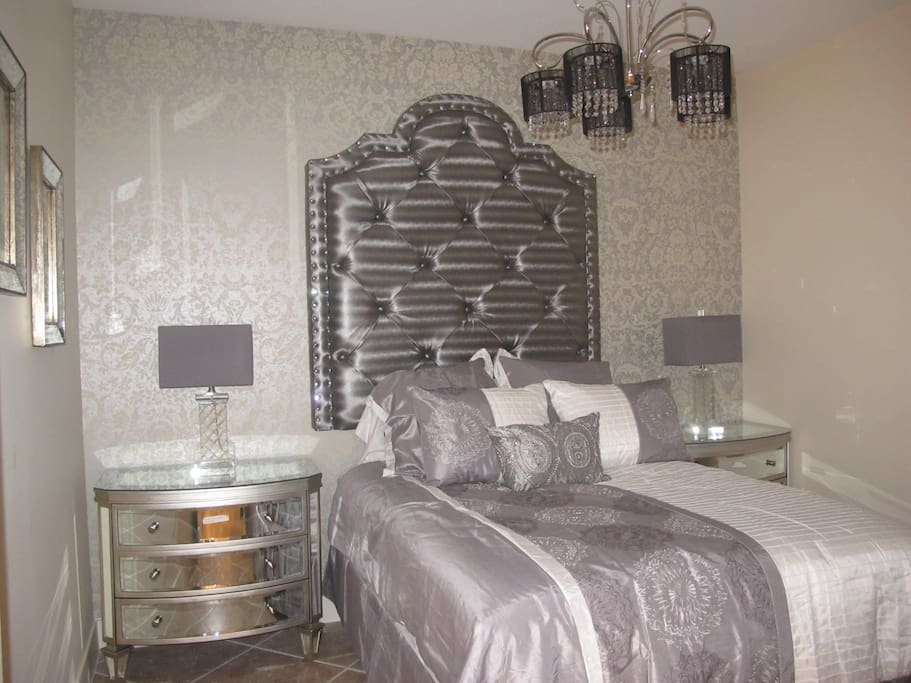 2nd guest bedroom with queen-size bed and 55 in. flat TV