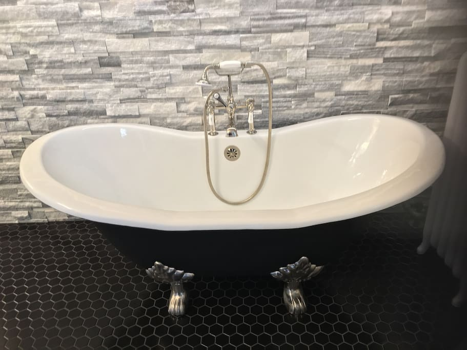 Our beautiful new cast iron tub.  We have bubblebath!