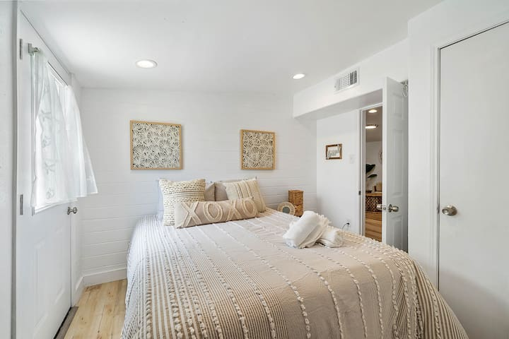 One of two bedrooms— this cozy space has a queen-size bed.