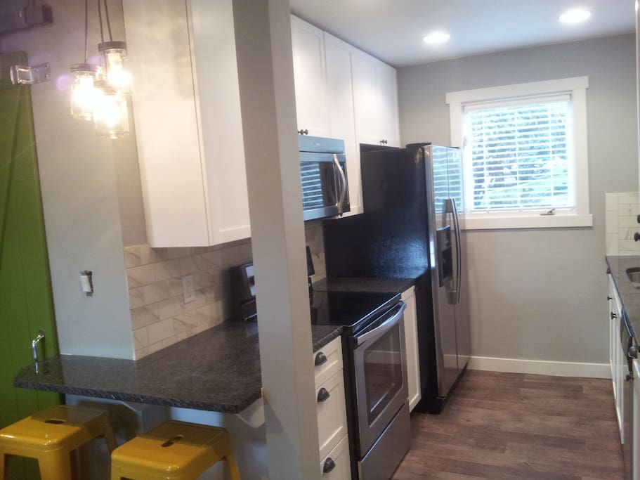 Brand new Kitchen with Granite Counter tops and new cabinets and appliances