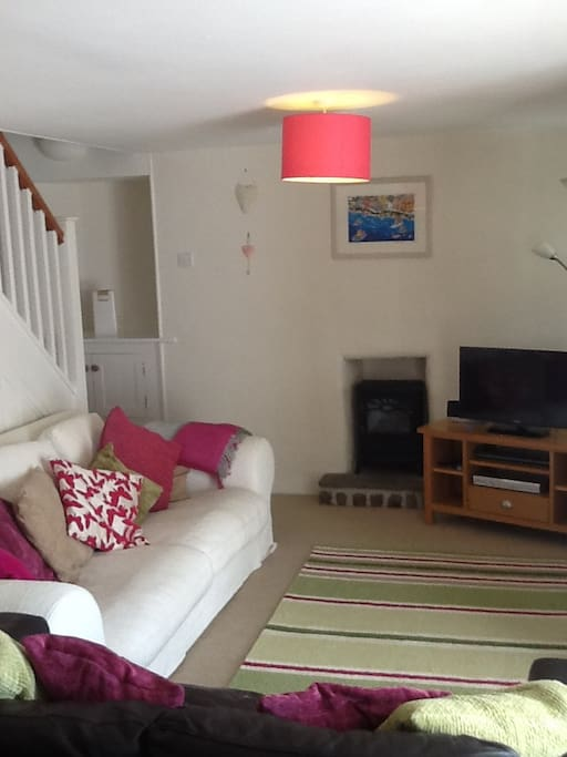The cosy open plan lounge has two sofas. Its light and airy with an adjoining conservatory for dining. There's a small electric fire, and sky TV plus a selection of books games and DVDS. There's a stereo in the conservatory with a selection of CDS