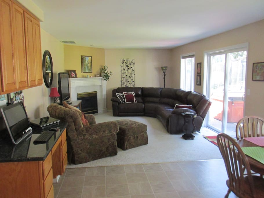 Open floor plan with leather furniture, large screen TV, etc.