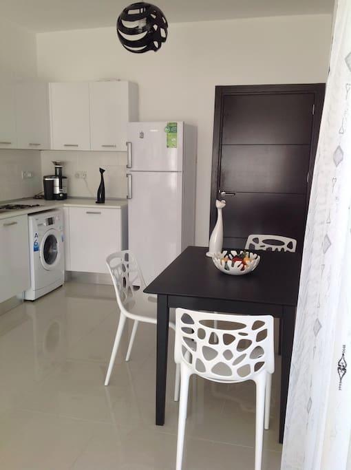 Dining area of a 2 bedroom apartment on the ground floor / Обеденная зона квартиры на первом этаже