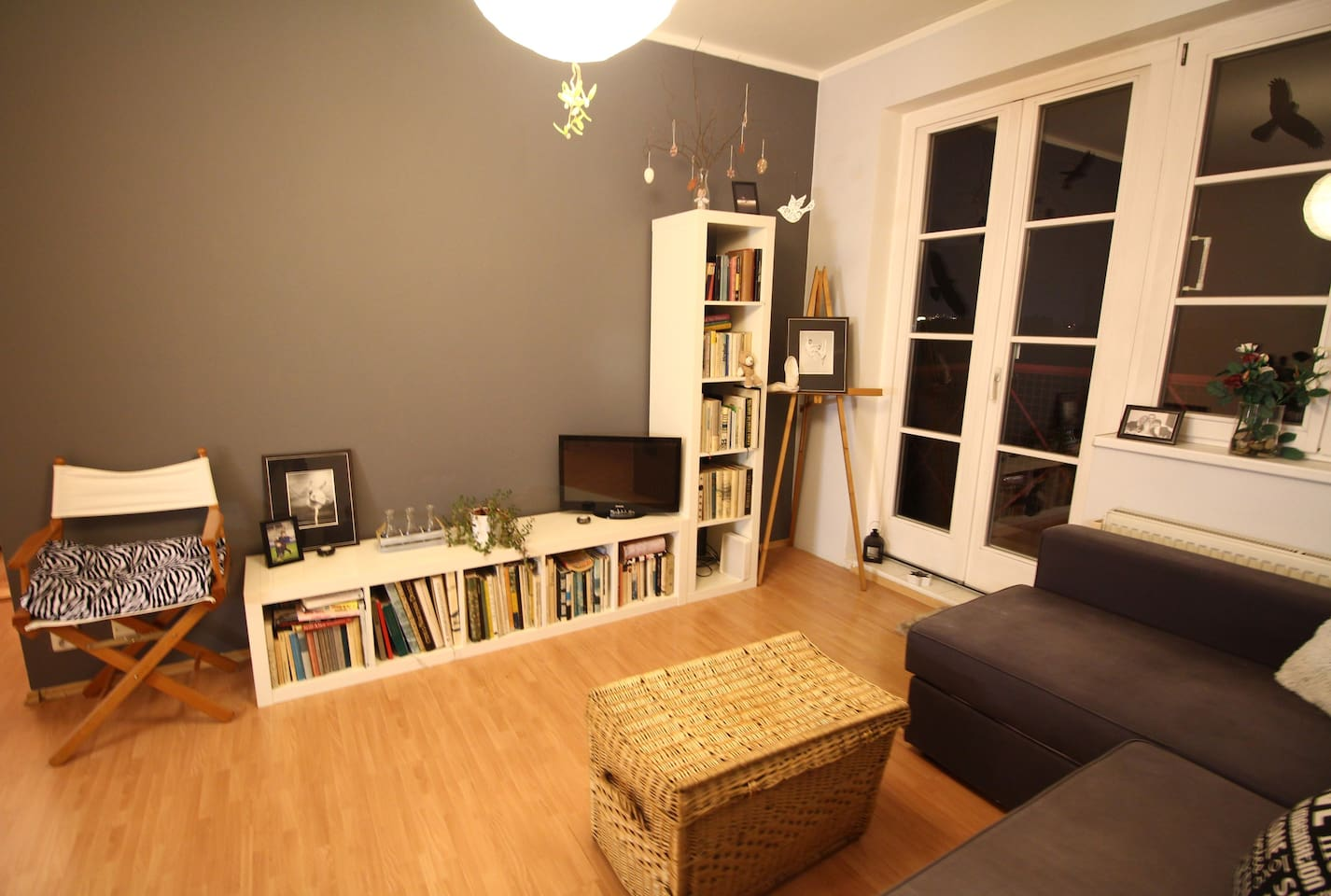 Living room with small TV and balcony entrance