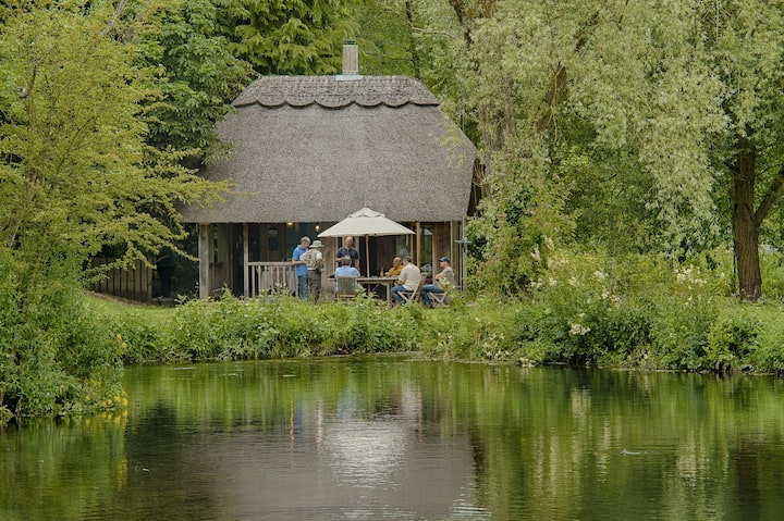Relax in our thatched cabin