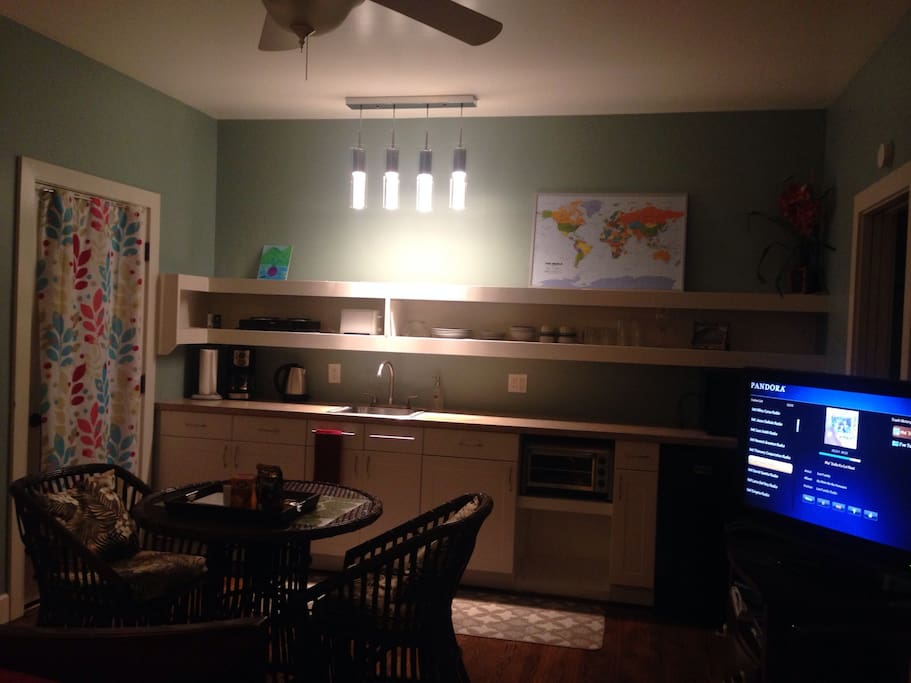 Fully equipped mini kitchen, dining area, entertainment center with TV DVD Pandora & Netflix