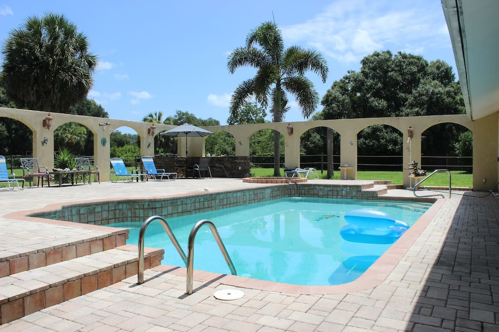 Enjoy the pool, spa, outdoor fireplace and kitchen