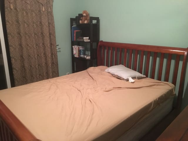 Full size real bed with wooden headboard
