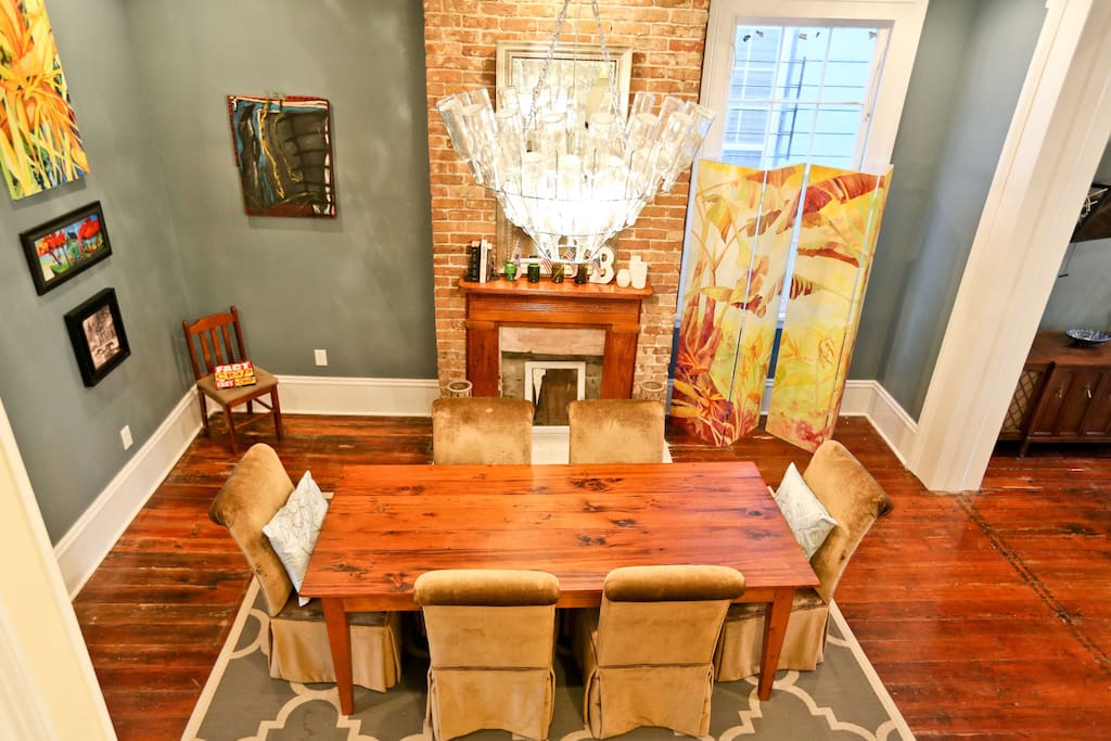 Dining room with historical coal burning fireplaces.