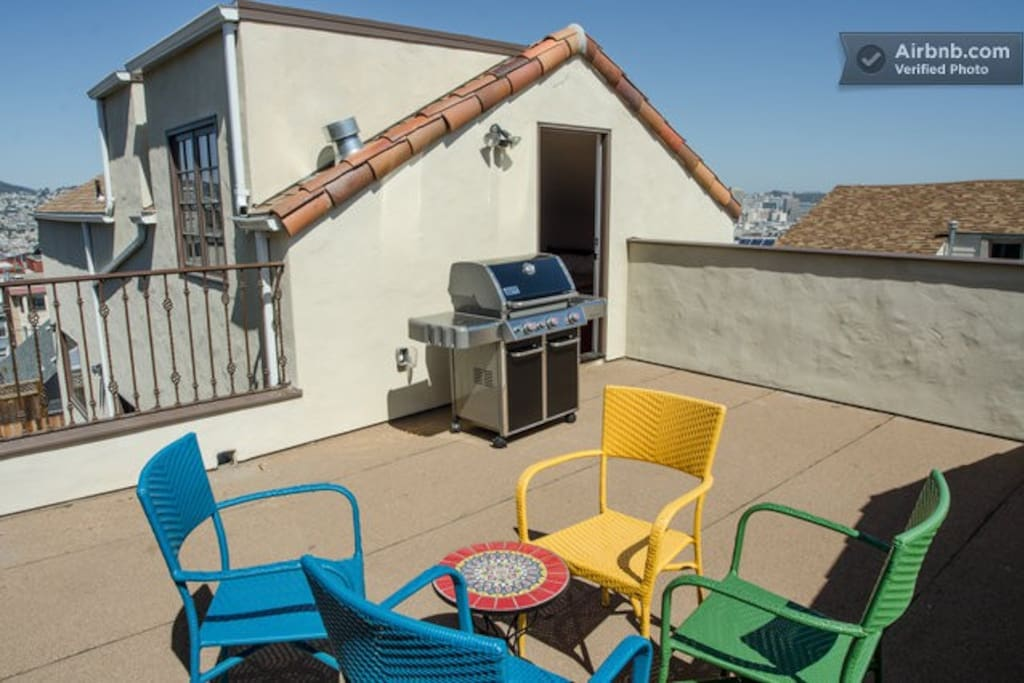 Large private deck with gas grill and patio furniture