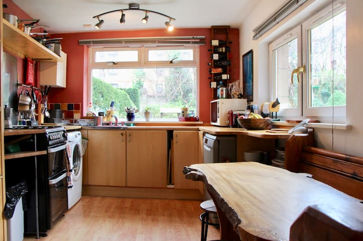 The kitchen on the ground floor has a hand made burr elm table with an old church per for seating. There is also a gas cooker; dishwasher; fridge freezer; microwave and washing machine.