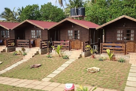 Deluxe AC Wooden Cottages - Baraka