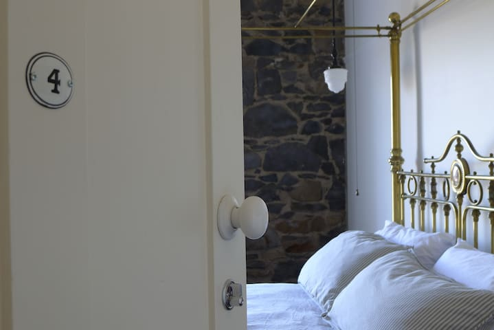 Guest Room 4 | Queen size antique brass bed